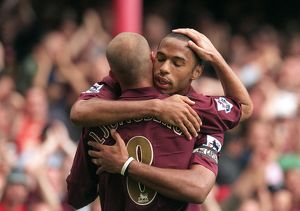 Thierry Henry celebrates scoring Arsenal's 1st goal from the penalty spot with Freddie Ljungberg
