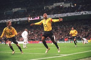 Thierry Henry celebrates scoring Arsenal's goal past Iker Casillas (Real)