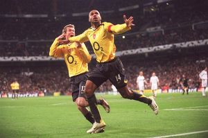 Thierry Henry celebrates scoring Arsenal's goal with Alex Hleb