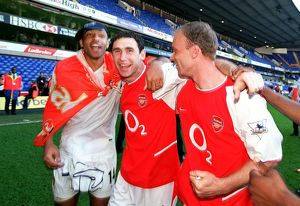 Thierry Henry, Martin Keown and Dennis Bergkamp (Arsenal) celebrate winning the league