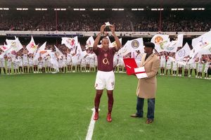 Thierry Henry is presented with a golden canon by Ian Wright for becoming Arsenal's all time record