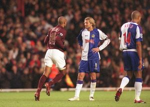 Thierry Henry runs past Robbie Savage (Blackburn) after scoring Arsenal's 2nd goal