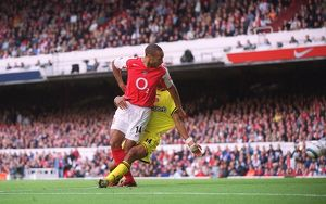 Thierry Henry scores his 1st goal, Arsenal's 2nd, under pressure from Jonathan Fortune