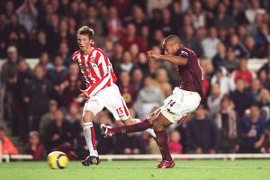 Thierry Henry scores Arsenal's 3rd goal watched by Danny Collins (Sunderland)
