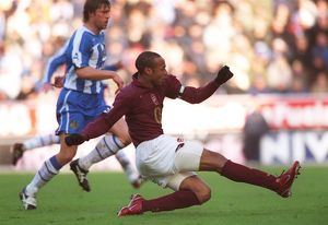 Thierry Henry shoots past Wigan goalkeeper John Filan to score the 2nd Arsenal goal