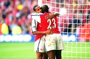 Thierry Henry and Sol Campbell celebrate the Arsenla victory