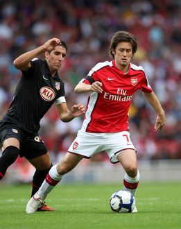 Tomas Rosicky (Arsenal) Raul Garcia (Atletico)