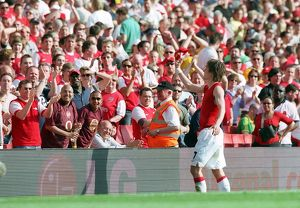 Tomas Rosicky (Arsenal) throws his shirt to the fans after the match