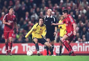 Tomas Rosicky beats Liverpool defender Steve Finan to score the 2nd Arsenal goal
