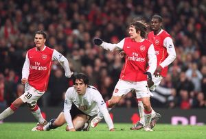 Tomas Rosicky scores Arsenal's 3rd goal watched Jeremie Aliadiere and Emmanuel Adebayor as Ricardo Rocha (Tottenham) looks on. Arsenal 3:1 Tottenham Hotspur. Carling Cup Semi Final 2nd Leg. Emirates Stadium, 31/1/07. Credit: Arsenal Football Club /