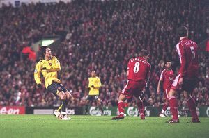 Tomas Rosicky shoots past Liverpool captain Steven Gerrard to score the 1st Arsenal goal