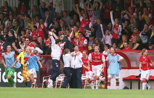 vic akers the arsenal manager celebrates