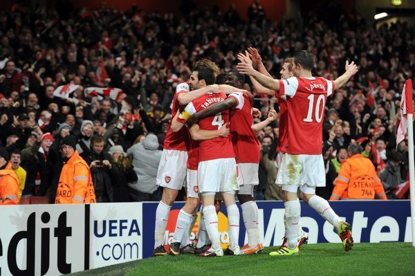 Andrey Arshavin celebrates scoring Arsenal's 2nd goal with his team mates