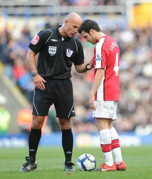 Arsenal captain Cesc Fabregas with referee Howard Webb. Birmingham City 1:1 Arsenal