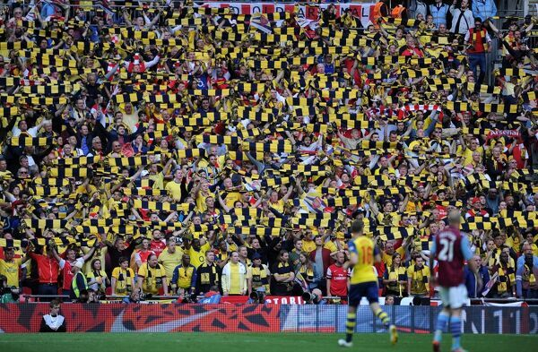 Arsenal fans hold up there scarves during the match. Arsenal 4:0 Aston Villa. FA Cup Final. Wembley Stadium, 30/5/15. Credit : Arsenal Football Club / David Price