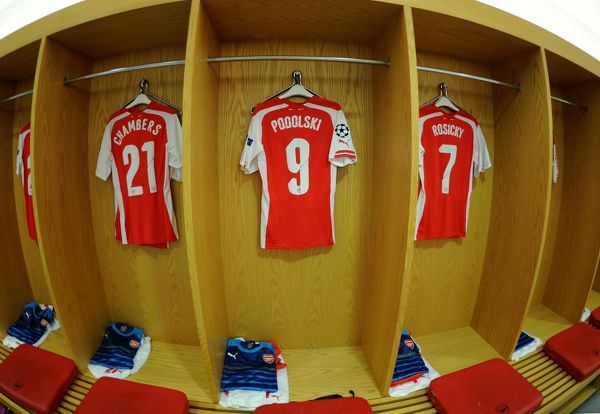 LONDON, ENGLAND - AUGUST 27: Calum Chambers, Lukas Podolski and Tomas Rosicky Arsenal shirts hanging in the changingroom before the UEFA Champions League Qualifing match between Arsenal and Besiktas at Emirates Stadium on August 27, 2014 in London, United Kingdom