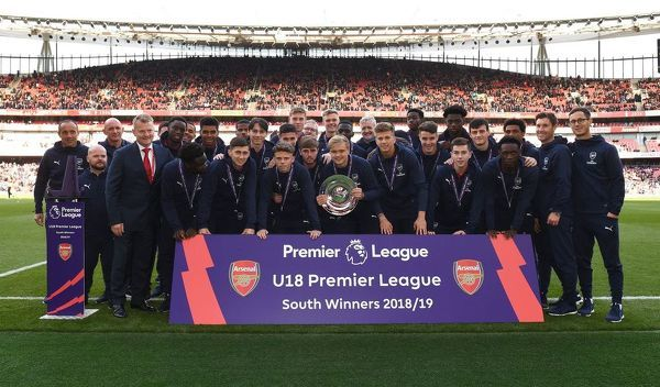 LONDON, ENGLAND - MAY 05: Arsenal U18s squad is presentted with the Premier League U18 South Shield at half time during the Premier League match between Arsenal FC and Brighton & Hove Albion at Emirates Stadium on May 5, 2019 in London, United Kingdom