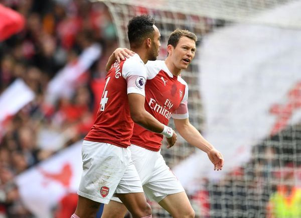 LONDON, ENGLAND - MAY 05: Pierre-Emerick Aubameyang celebrates scoring a goal for Arsenal with Stephan Lichtsteiner during the Premier League match between Arsenal FC and Brighton & Hove Albion at Emirates Stadium on May 5, 2019 in London, United Kingdom