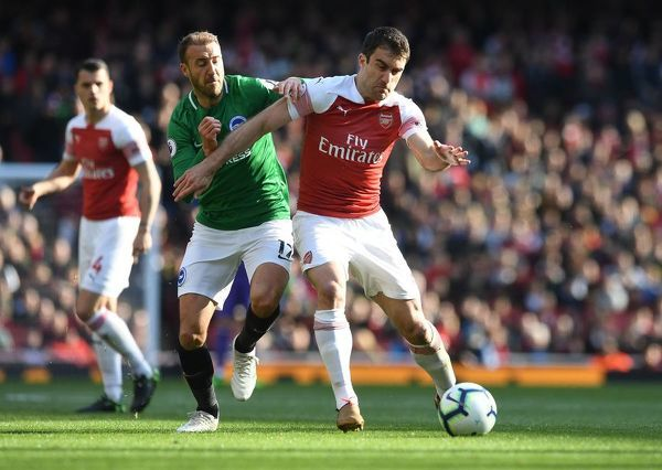 LONDON, ENGLAND - MAY 05: Sokratis of Arsenal is challenged by Glenn Murray of Brigthon during the Premier League match between Arsenal FC and Brighton & Hove Albion at Emirates Stadium on May 5, 2019 in London, United Kingdom
