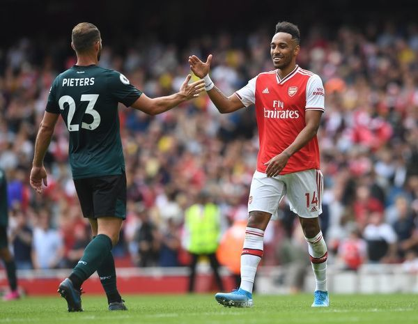 LONDON, ENGLAND - AUGUST 17: Pierre-Emerick Aubameyang of Arsenal high fives Erik Pieters of Stoke after the Premier League match between Arsenal FC and Burnley FC at Emirates Stadium on August 17, 2019 in London, United Kingdom