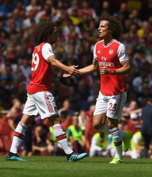 LONDON, ENGLAND - AUGUST 17: David Luiz and Matteo Guendouzi of Arsenal during the Premier League match between Arsenal FC and Burnley FC at Emirates Stadium on August 17, 2019 in London, United Kingdom
