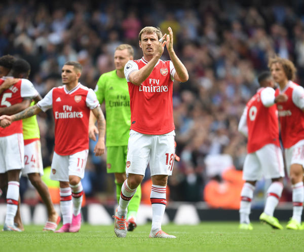 LONDON, ENGLAND - AUGUST 17: Arsenal captain Nacho Monreal applauds the fans after the Premier League match between Arsenal FC and Burnley FC at Emirates Stadium on August 17, 2019 in London, United Kingdom