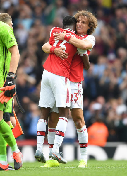 LONDON, ENGLAND - AUGUST 17: (R) David Luiz and (L) Ainsley Maitland-Niles hug after Arsenal's win in the Premier League match between Arsenal FC and Burnley FC at Emirates Stadium on August 17, 2019 in London, United Kingdom
