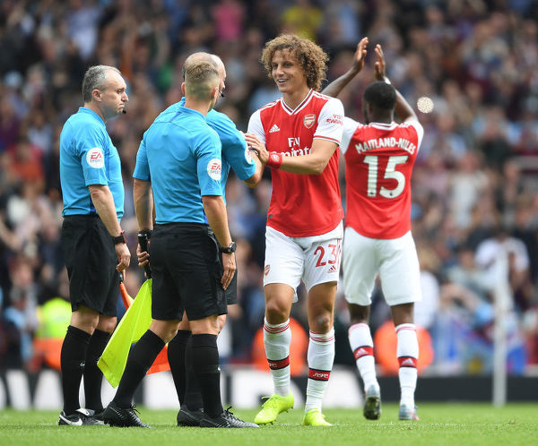 LONDON, ENGLAND - AUGUST 17: Arsenal defender David Luiz shakes hands with the officials after the Premier League match between Arsenal FC and Burnley FC at Emirates Stadium on August 17, 2019 in London, United Kingdom