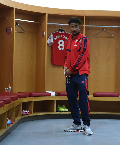 LONDON, ENGLAND - AUGUST 17: Reiss Nelson in the Arsenal changing room before the Premier League match between Arsenal FC and Burnley FC at Emirates Stadium on August 17, 2019 in London, United Kingdom
