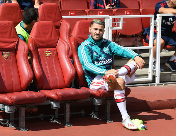 LONDON, ENGLAND - AUGUST 17: Arsenal substitute Sead Kolasinac on the bench before the Premier League match between Arsenal FC and Burnley FC at Emirates Stadium on August 17, 2019 in London, United Kingdom