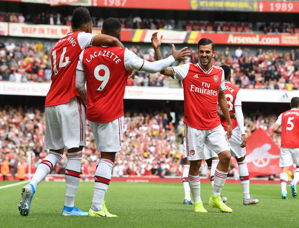 LONDON, ENGLAND - AUGUST 17: (2ndL) Alex Lacazette celebrates scoring the 1st Arsenal goal with (L) Pierre-Emerick Aubameyang and (R) Dani Ceballos during the Premier League match between Arsenal FC and Burnley FC at Emirates Stadium on August 17