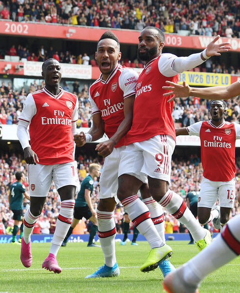 LONDON, ENGLAND - AUGUST 17: (2ndL) Pierre-Emerick Aubameyang celebrates scoring the 2nd Arsenal goal with (L) Nicolas Pepe and (R) Alex Lacazette during the Premier League match between Arsenal FC and Burnley FC at Emirates Stadium on August 17