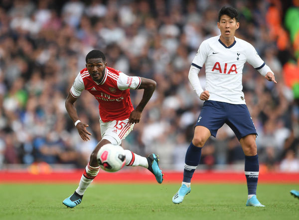 LONDON, ENGLAND - SEPTEMBER 01: Ainsley Maitland-Niles of Arsenal takes on Heung-Min Son of Tottenham during the Premier League match between Arsenal FC and Tottenham Hotspur at Emirates Stadium on September 01, 2019 in London, United Kingdom