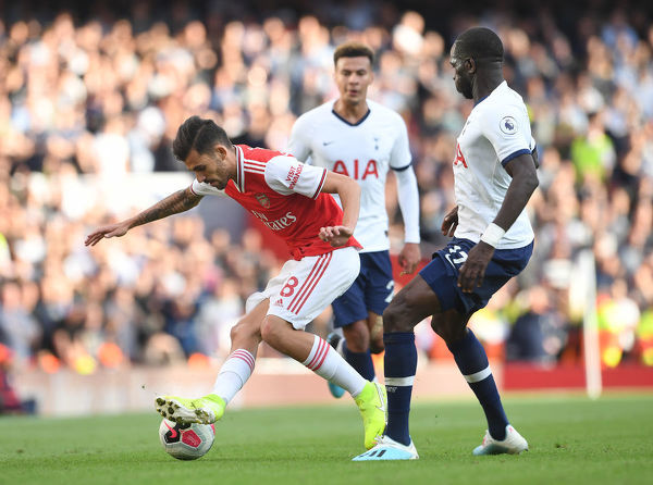 LONDON, ENGLAND - SEPTEMBER 01: Dani Ceballos of Arsenal turns away from Moussa Sissoko of Tottenham during the Premier League match between Arsenal FC and Tottenham Hotspur at Emirates Stadium on September 01, 2019 in London, United Kingdom