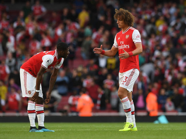 LONDON, ENGLAND - SEPTEMBER 01: David Luiz goes to shake hands with Ainsley Maitland-Niles of Arsenal after the Premier League match between Arsenal FC and Tottenham Hotspur at Emirates Stadium on September 01, 2019 in London, United Kingdom