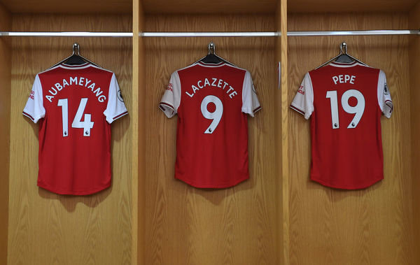 LONDON, ENGLAND - SEPTEMBER 01: Pierre-Emerick Aubameyang, Alexandre Lacazette and Nicolas Pepe's Arsenal shirts in the changingroom before the Premier League match between Arsenal FC and Tottenham Hotspur at Emirates Stadium on September 01, 2019 in London, United Kingdom