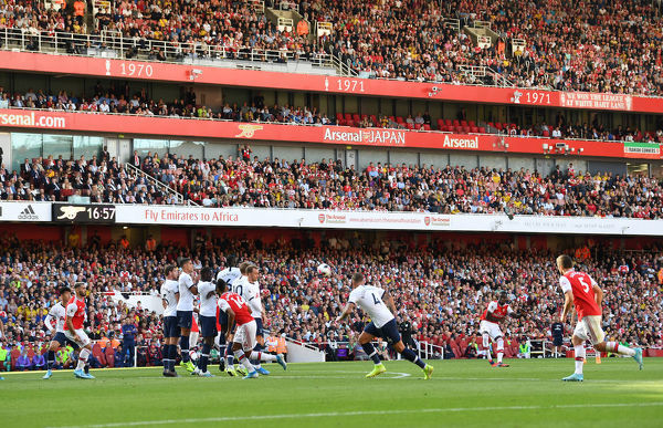 LONDON, ENGLAND - SEPTEMBER 01: Nicolas Pepe of Arsenal takes a free kick during the Premier League match between Arsenal FC and Tottenham Hotspur at Emirates Stadium on September 01, 2019 in London, United Kingdom