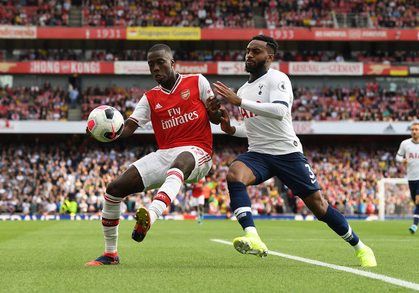 LONDON, ENGLAND - SEPTEMBER 01: Nicolas Pepe of Arsenal is closed down by Danny Rose of Tottenham during the Premier League match between Arsenal FC and Tottenham Hotspur at Emirates Stadium on September 01, 2019 in London, United Kingdom
