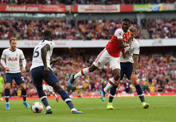 LONDON, ENGLAND - SEPTEMBER 01: Ainsley Maitland-Niles of arsenal is challenged by Toby Alderweireld of Tottenham during the Premier League match between Arsenal FC and Tottenham Hotspur at Emirates Stadium on September 01, 2019 in London, United Kingdom