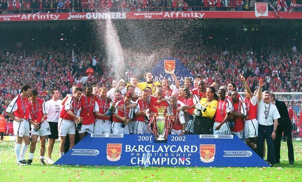 the arsenal team celebrate winning the f