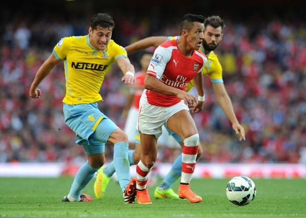 LONDON, ENGLAND - AUGUST 16: Alexis Sanchez of Arsenal takes on Joel Ward of Palace during the Barclays Premier League match between Arsenal and Crystal Palace at Emirates Stadium on August 16, 2014 in London, England
