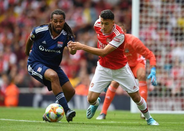 LONDON, ENGLAND - JULY 28: Gabriel Martinelli of Arsenal takes on Jason Denayer of Lyon during the match between Arsenal and Olympique Lyonnais at Emirates Stadium on July 28, 2019 in London, England