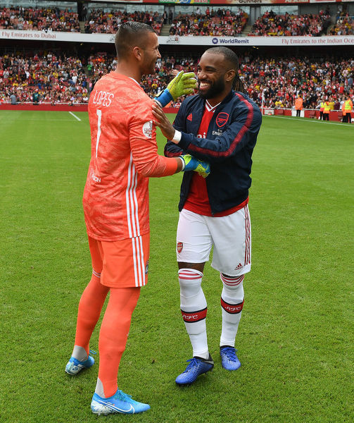 LONDON, ENGLAND - JULY 28: Alex Lacazette of Arsenal greets Lyon goalkeeper Anthony Poles before the Emirates Cup match between Arsenal and Olympic Lyonnais at Emirates Stadium on July 28, 2019 in London, England