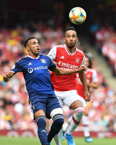 LONDON, ENGLAND - JULY 28: Pierre-Emerick Aubameyang of Arsenal challenges Fernando Marcal of Lyon during the Emirates Cup match between Arsenal and Olympic Lyonnais at Emirates Stadium on July 28, 2019 in London, England