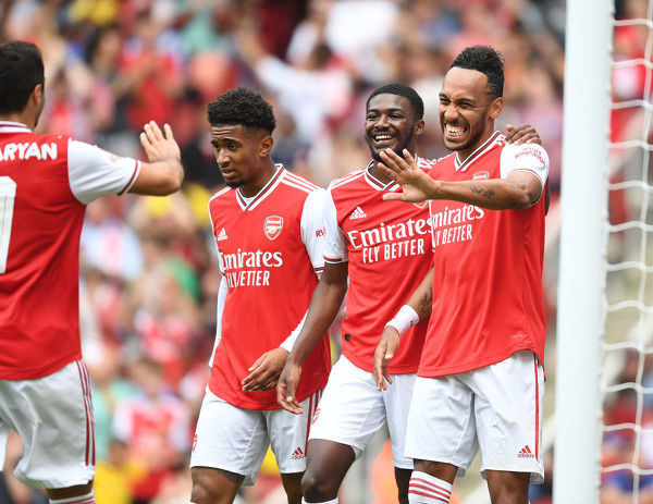 LONDON, ENGLAND - JULY 28: (R) Pierre-Emerick Aubameyang celebrates scoring Arsenal's goal with (L) Henrikh Mkhitaryan, (2ndL) Reiss Nelson and (2ndR) Ainsley Maitland-Niles during the Emirates Cup match between Arsenal and Olympic Lyonnais at Emirates Stadium on July 28
