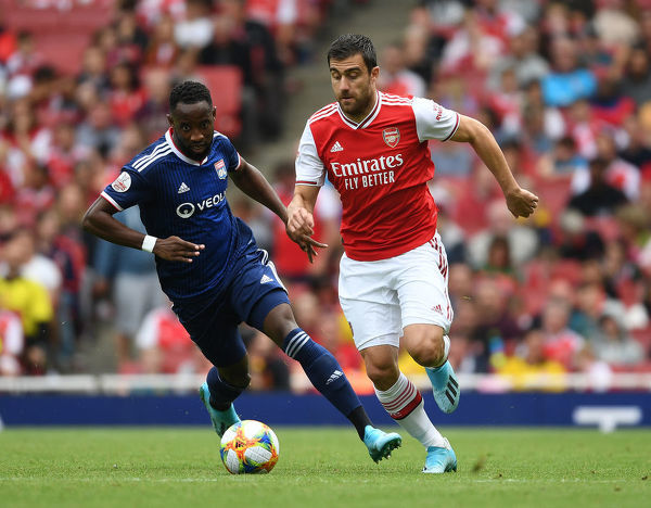 LONDON, ENGLAND - JULY 28: Sokratis of Arsenal breaks past Moussa Dembele of Lyon during the Emirates Cup match between Arsenal and Olympic Lyonnais at Emirates Stadium on July 28, 2019 in London, England