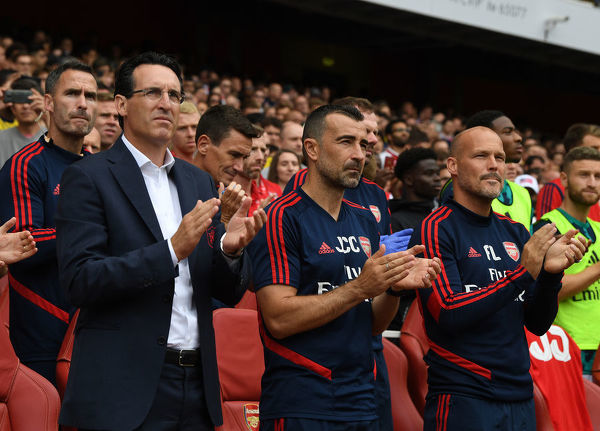 LONDON, ENGLAND - JULY 28: Arsenal Head Coach Unai Emery and assistants Juan Carlos Carcedo and Freddie Ljungberg observe a period of applause for ex player Jose Reyes before the Emirates Cup match between Arsenal and Olympic Lyonnais at Emirates Stadium on July 28