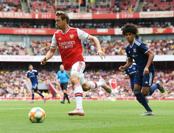 LONDON, ENGLAND - JULY 28: Nacho Monreal of Arsenal breaks past Boubacar Fofana of Lyon during the Emirates Cup match between Arsenal and Olympic Lyonnais at Emirates Stadium on July 28, 2019 in London, England
