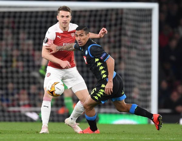 LONDON, ENGLAND - APRIL 11: Aaron Ramsey of Arsenal challenges Allan of Napoli during the UEFA Europa League Quarter Final First Leg match between Arsenal and S
