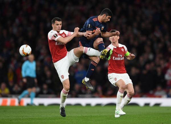 LONDON, ENGLAND - MAY 02: Granit Xhaka of Arsenal challenges Goncalo Guedes of Valencia during the UEFA Europa League Semi Final First Leg match between Arsenal and Valencia at Emirates Stadium on May 2, 2019 in London, England